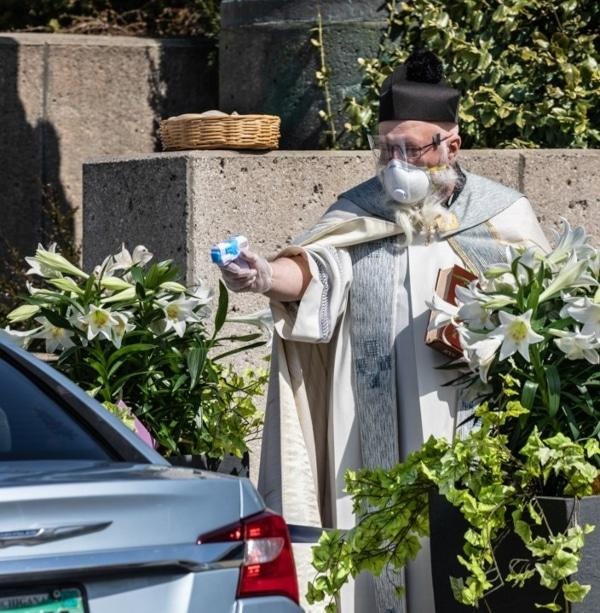 This Priest Is Going Viral For Shooting Holy Water With A Squirt Gun During Socially Distanced Service