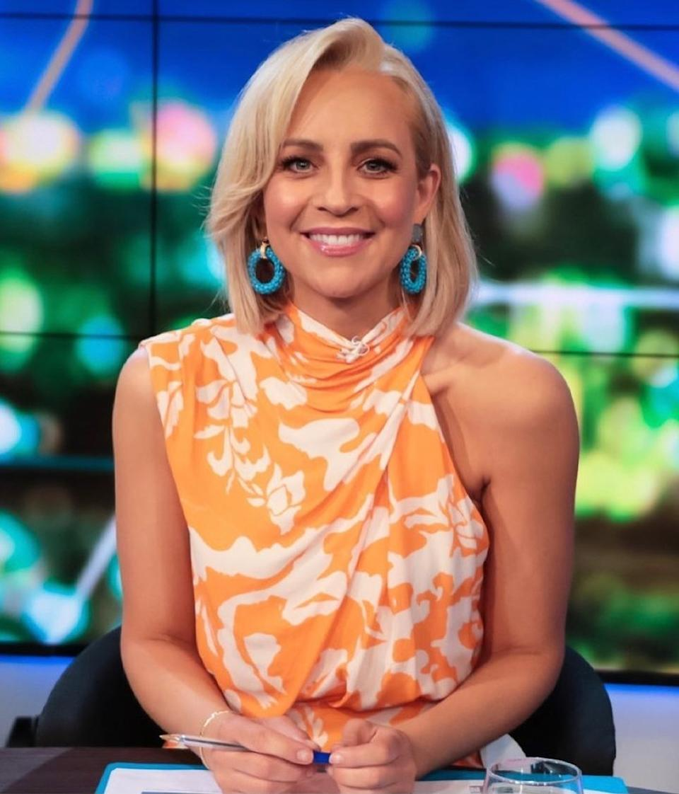 The Project host Carrie Bickmore wearing an orange print dress by Sheike