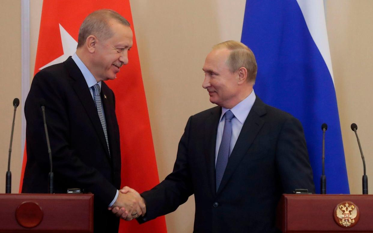 Recep Tayyip Erdogan and Vladimir Putin emerged from marathon talks in Sochi with an agreement - AFP