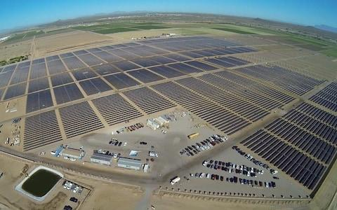 Apple's 50-megawatt solar farm, east of Apple's data center in Mesa, Arizona is pictured in this undated handout photo obtained by Reuters - Credit: Reuters