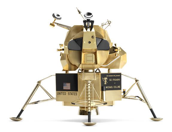 Lunar landing module by Cartier, French; made of yellow gold, white gold, black lacquer, and red, white, and blue enamel.
