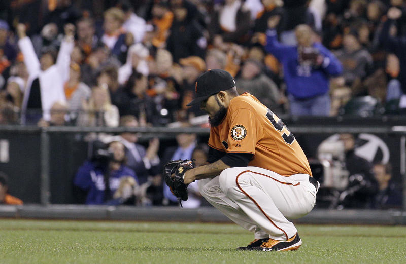 San Francisco Giants pitcher Sergio Romo reacts after allowing a two-run home run to Los Angeles Dodgers' Hanley Ramirez in the 10th inning of a baseball game in San Francisco, Friday, July 27, 2012. (AP Photo/Jeff Chiu)