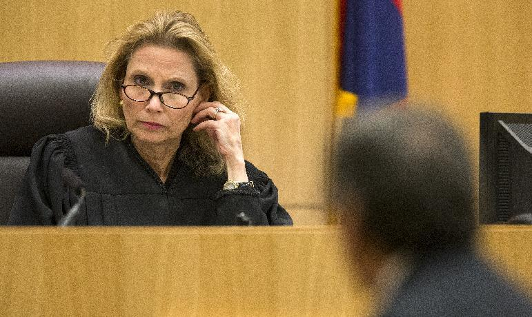 Judge Sherry Stephens left, listens to prosecutor Juan Martinez during the cross examination of Jodi Arias in Maricopa County Superior Court, Tuesday, Feb. 26, 2013. Arias is on trial for the murder of her boyfriend, Travis Alexander, in 2008. (AP Photo/The Arizona Republic, Tom Tingle) MARICOPA COUNTY OUT; MAGS OUT; NO SALES