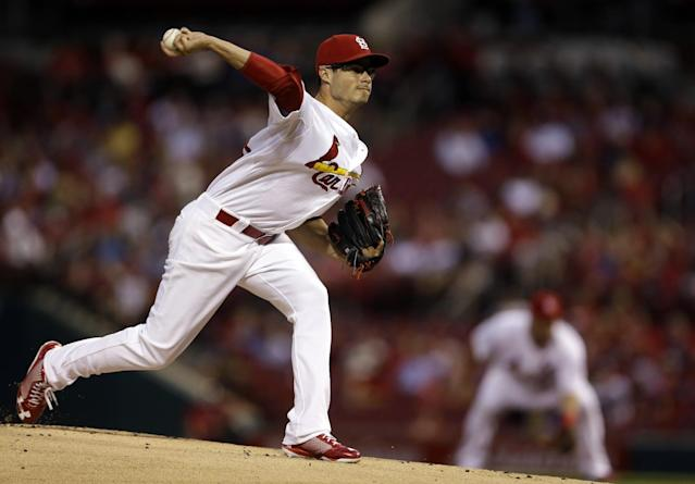 St. Louis Cardinals starting pitcher Joe Kelly throws during the first inning of a baseball game against the Milwaukee Brewers, Thursday, Sept. 12, 2013, in St. Louis. (AP Photo/Jeff Roberson)