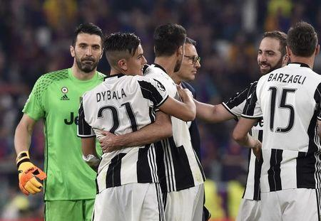 Juventus' Paulo Dybala celebrates after the match with team mates