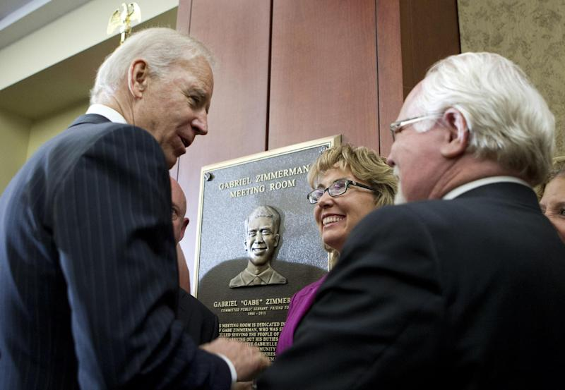 Vice President Joe Biden speaks with former Rep. Gabrielle Giffords, D-Ariz. and Rep. Ron Barber, D-Ariz., during the dedication of a room in the Capitol Visitors Center to slain congressional staffer Gabriel Zimmerman on Capitol Hill, in Washington, Tuesday, April 16, 2013. Zimmerman died two years ago in the Tucson, Ariz., attack that critically wounded Giffords and took six lives. (AP Photo/Jose Luis Magana)