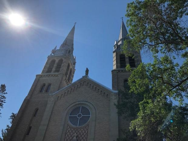 Saskatchewan Roman Catholic bishops announced plans to revive fundraising efforts for residential school survivors. It's unclear whether they'll pause the $17-million fundraising campaign for renovations to Regina's Holy Rosary Cathedral (above) while the survivor funds are raised, as some have demanded. (Richard Agecoutay/CBC - image credit)