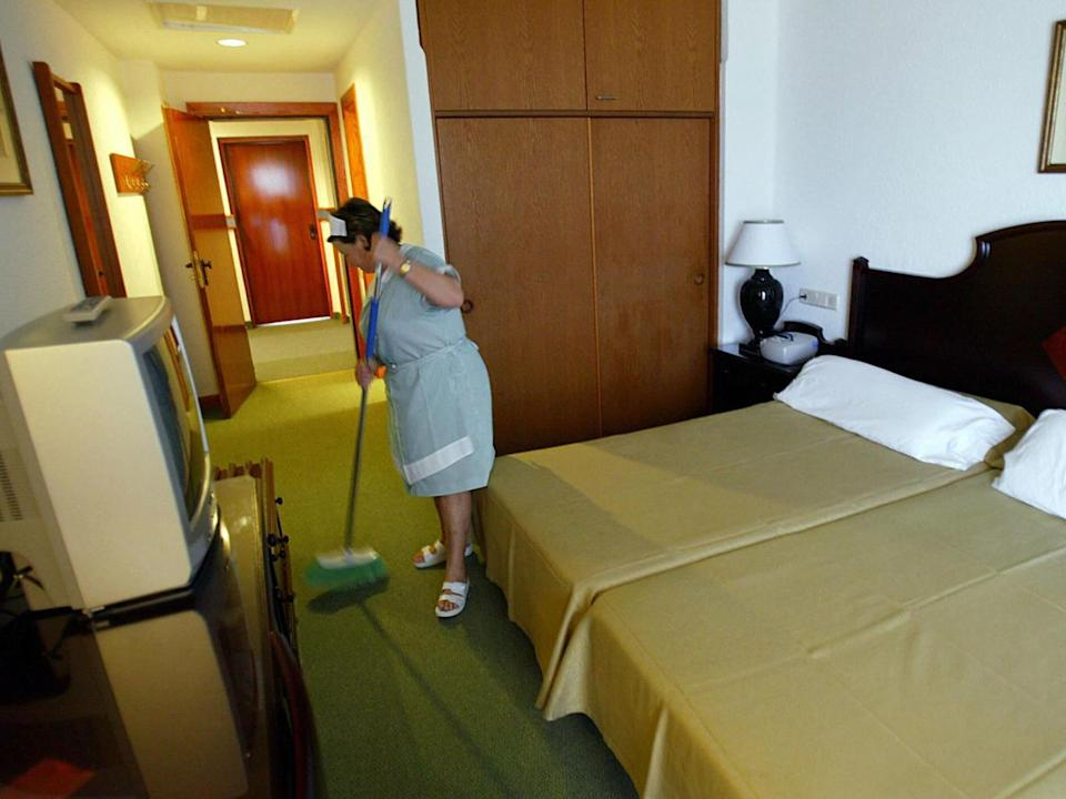 A maid cleans a room (Getty)