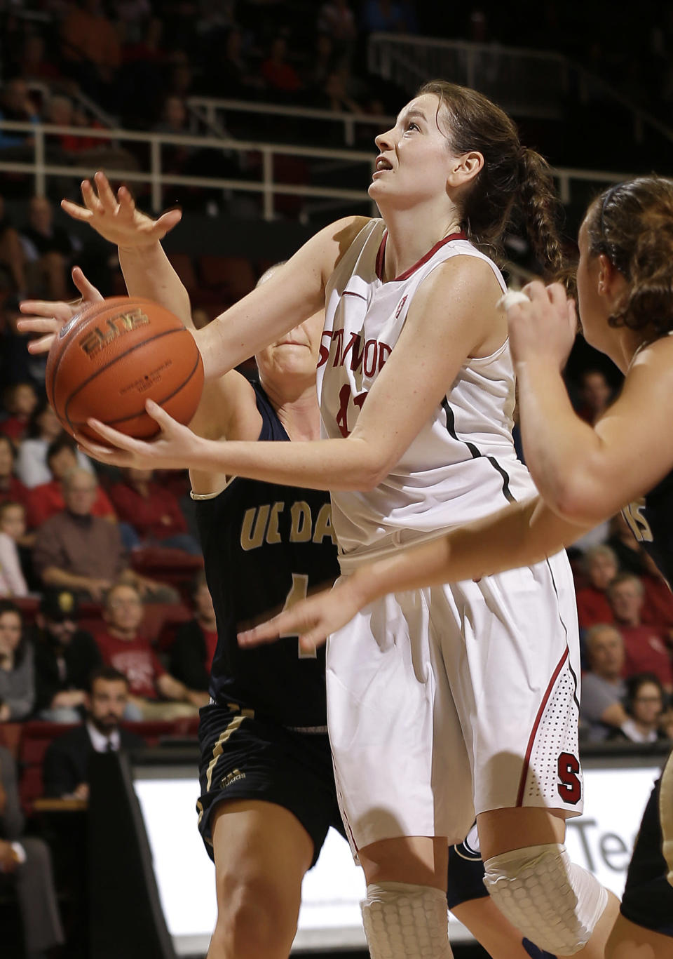 Stanford forward Bonnie Samuelson, center, shoots against UC Davis during the second half of an NCAA college basketball game in Stanford, Calif., Monday, Dec. 22, 2014. Stanford won 71-59. (AP Photo/Jeff Chiu)