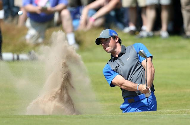 Rory McIlroy of Northern Ireland plays out of a bunker on the 16th hole during the first day of the British Open Golf championship at the Royal Liverpool golf club, Hoylake, England, Thursday July 17, 2014. (AP Photo/Peter Morrison)