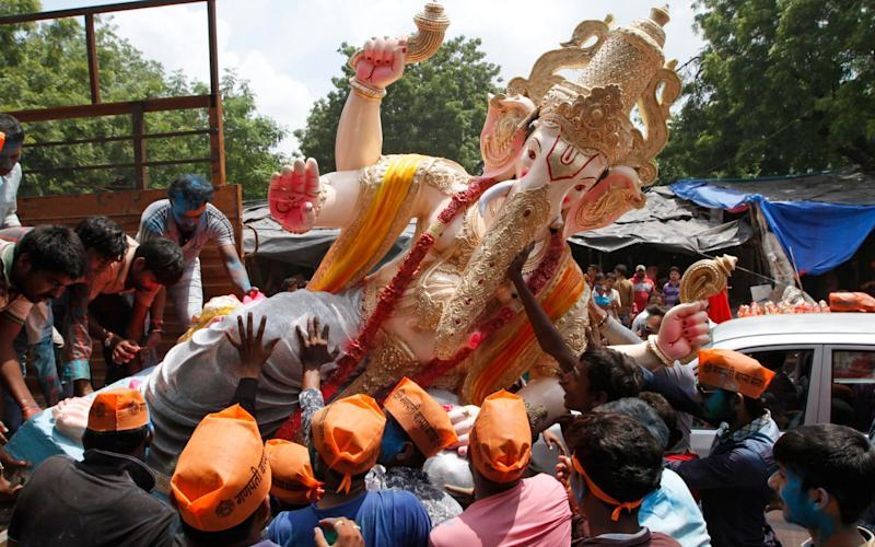 Prime Minister Modi suggested that the Hindu god Ganesh showed ancient Indians were capable of plastic surgery - AP