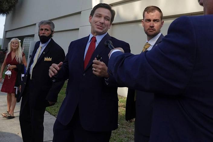 Florida Gov. Ron DeSantis leaves the site of an appearance, Thursday, May 6, 2021, in West Palm Beach, where he signed a sweeping elections bill into law. The event was closed to the news media except for Fox News.