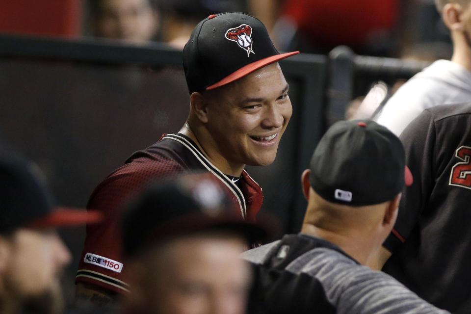 Arizona Diamondbacks' Taijuan Walker gives a smile to teammates after a successful first outing against the San Diego Padres during the first inning of a baseball game Sunday, Sept. 29, 2019, in Phoenix. Taijuan Walker made his first appearance on a Major League mound since April 14, 2018. Taijuan Walker threw 15 pitches, eleven for strikes in his only inning of pitching. (AP Photo/Darryl Webb)