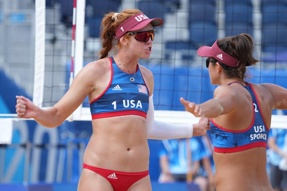 U.S. beach volleyball players Kelly Claes (1) and Sarah Sponcil (2) on Jul 26, 2021, during the Tokyo Olympics.