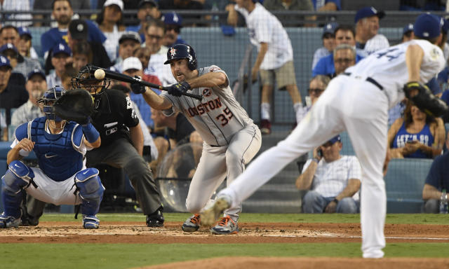 <p>Houston Astros starting pitcher Justin Verlander (35) hits a sacrifice bunt against the Los Angeles Dodgers in the third inning in game two of the 2017 World Series at Dodger Stadium. Mandatory Credit: Robert Hanashiro-USA TODAY Sports </p>