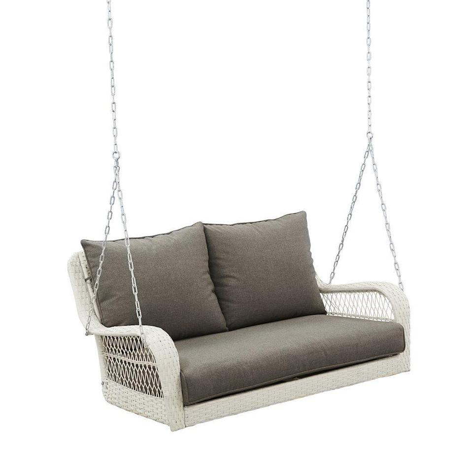 """<p><strong>Better Homes & Gardens</strong></p><p>walmart.com</p><p><strong>$289.97</strong></p><p><a href=""""https://go.redirectingat.com?id=74968X1596630&url=https%3A%2F%2Fwww.walmart.com%2Fip%2FBetter-Homes-Gardens-Colebrook-Outdoor-Porch-Swing%2F839768698&sref=https%3A%2F%2Fwww.countryliving.com%2Fhome-design%2Fdecorating-ideas%2Fg32815195%2Fbest-porch-swings%2F"""" rel=""""nofollow noopener"""" target=""""_blank"""" data-ylk=""""slk:Shop Now"""" class=""""link rapid-noclick-resp"""">Shop Now</a></p><p>How cute is this cushioned white wicker porch swing!? Its woven exterior adds quaint, cottage-style charm to the outside of any home. Perch it overlooking a blooming flower garden, and you'll feel like you're in a fairytale escape.</p><p>It features a steel frame that holds up to 450 lbs., so you and a friend can safely laze the day away together.</p>"""