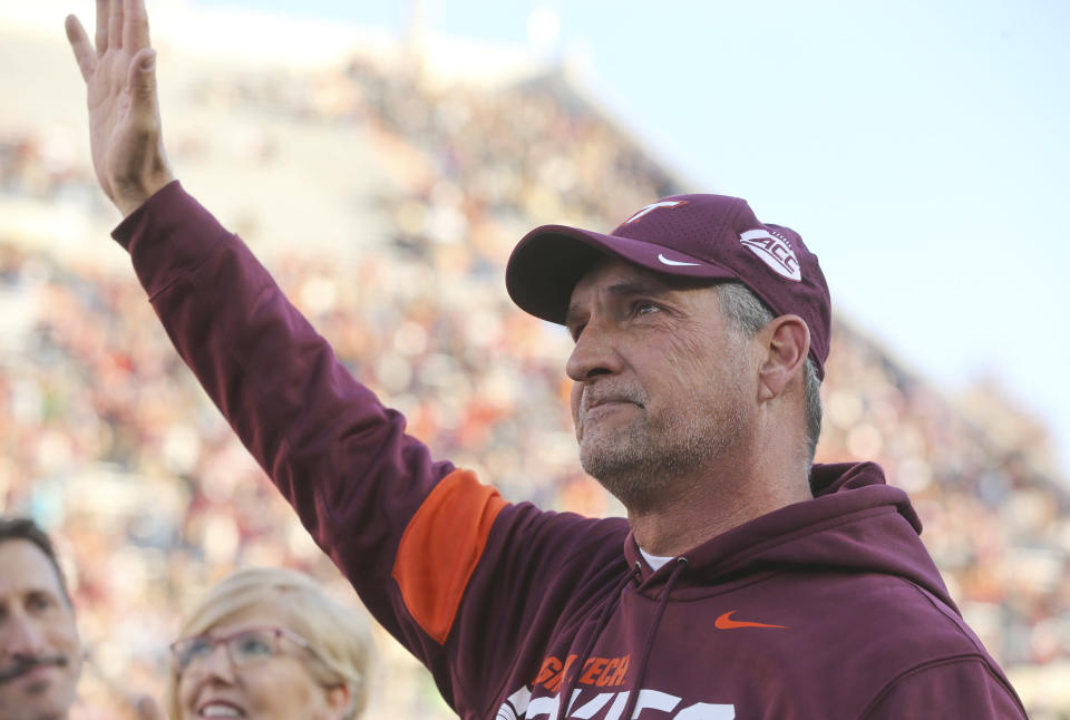 Virginia Tech defensive coordinator Bud Foster, who is retiring after the season, waves at the end of a ceremony in his honor, before the team's NCAA college football game against Wake Forest on Saturday, Nov. 9, 2019, in Blacksburg, Va. (Matt Gentry/The Roanoke Times via AP)