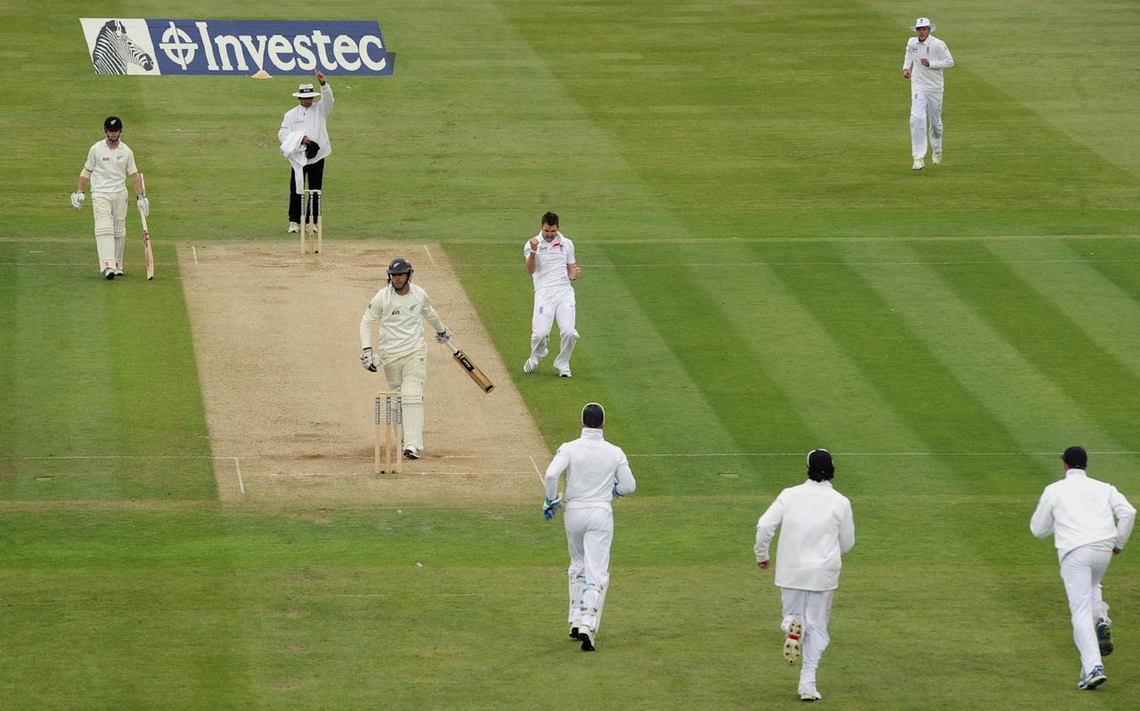 England's James Anderson (centre) celebrates taking the wicket of New Zealand's Ross Taylor for 66 during the first test at Lord's Cricket Ground, London.