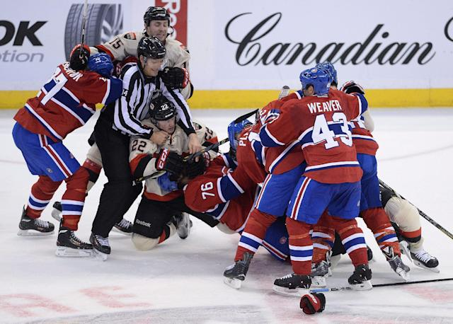 The Ottawa Senators and Montreal Canadiens fight during second period NHL hockey action in Ottawa on Friday, April 4, 2014. (AP Photo/The Canadian Press, Sean Kilpatrick)