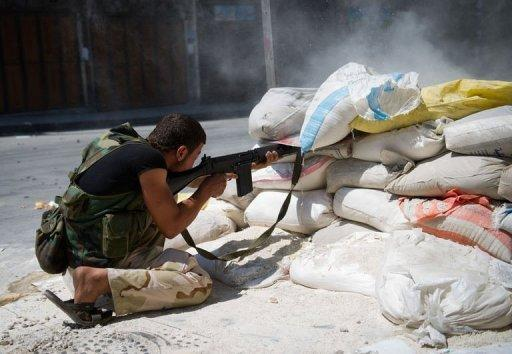 A Syrian rebel from the Free Syrian Army fires a sniper towards government forces in the Bab Al-Nasr district of the northern restive city of Aleppo
