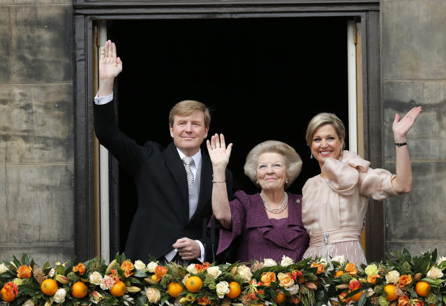Dutch King Willem-Alexander, Queen Maxima, right, and Princess Beatrix appear on the balcony of the Royal Palace in Amsterdam, The Netherlands, Tuesday April 30, 2013. Around a million people are expected to descend on the Dutch capital for a huge street party to celebrate the first new Dutch monarch in 33 years. (AP Photo/Daniel Ochoa de Olza)