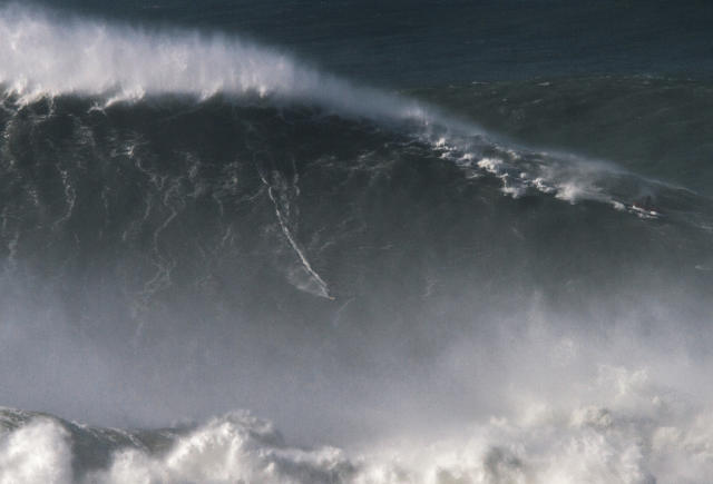 Brazilian surfer Rodrigo Koxa took on an 80-foot wave in Portugal that almost killed him in 2014 and walked away with a world record. (AP)