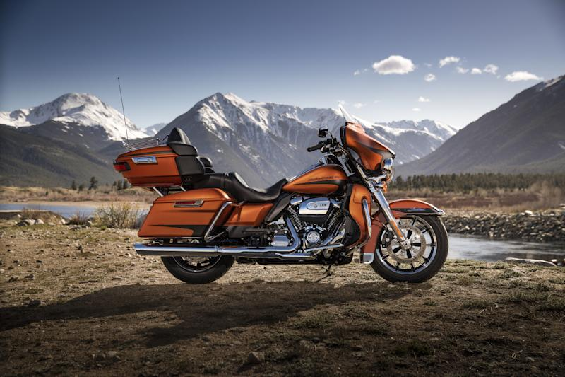 A Harley-Davidson motorcycle in a mountain landscape.