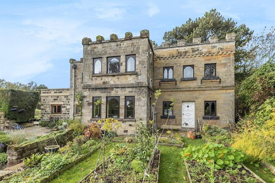 """<p>With a castle-like facade, this beautiful home looks like it belongs in a picture book. A rare opportunity for someone to purchase the period home, it has three reception rooms, a modern kitchen, pretty period features, and a garden so lovely <a href=""""https://www.housebeautiful.com/uk/garden/g32386205/monty-don-garden/"""" rel=""""nofollow noopener"""" target=""""_blank"""" data-ylk=""""slk:Monty Don"""" class=""""link rapid-noclick-resp"""">Monty Don</a> would be proud. </p><p><a href=""""https://www.zoopla.co.uk/for-sale/details/56837125/"""" rel=""""nofollow noopener"""" target=""""_blank"""" data-ylk=""""slk:This property is currently on the market for £650,000 with Hunters via Zoopla."""" class=""""link rapid-noclick-resp"""">This property is currently on the market for £650,000 with Hunters via Zoopla.</a></p>"""