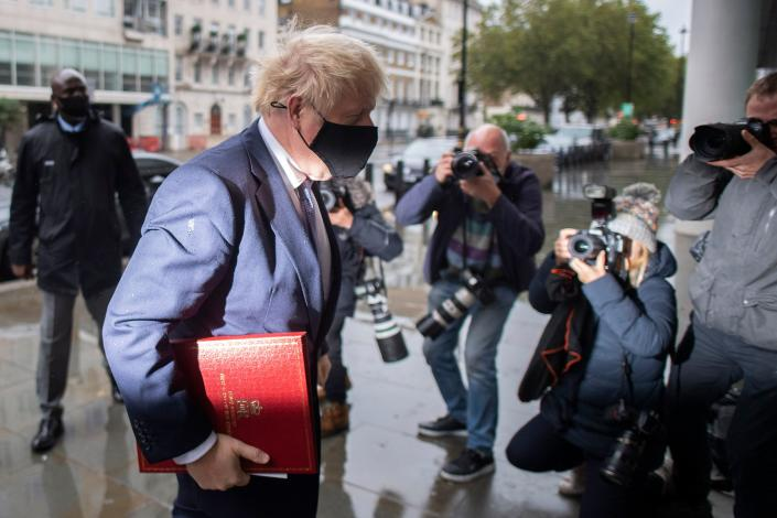 """Britain's Prime Minister Boris Johnson wears a protective face covering as he arrives at the BBC in central London on October 4, 2020, to take part in the BBC political programme The Andrew Marr Show. - British Prime Minister Boris Johnson and EU chief Ursula von der Leyen on Saturday asked their negotiators to """"work intensively"""" to overcome differences to secure a post-Brexit free trade deal. (Photo by JUSTIN TALLIS / AFP) (Photo by JUSTIN TALLIS/AFP via Getty Images)"""