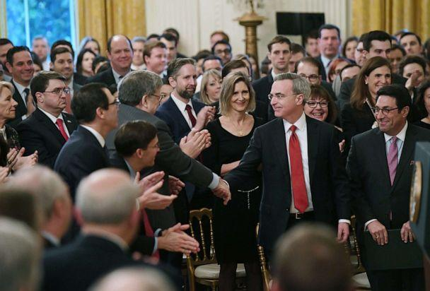 PHOTO: White House defense team lawyer Pat Cipollone, center, shakes hands with Attorney General William Barr before President Donald Trump speaks about his Senate impeachment trial in the East Room of the White House, Feb. 6, 2020. (Saul Loeb/AFP via Getty Images)