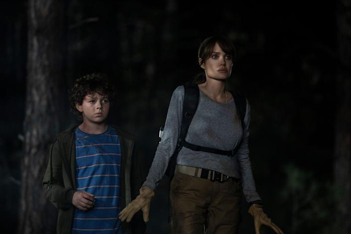 """Connor (Finn Little, left) and Hannah (Angelina Jolie) fight to survive in """"Those Who Wish Me Dead."""""""