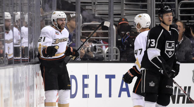 Anaheim Ducks right wing Kyle Palmieri, left, celebrates his goal with defenseman Hampus Lindholm, center, of Sweden, as Los Angeles Kings center Tyler Toffoli looks on during the second period in Game 6 of an NHL hockey second-round Stanley Cup playoff series, Wednesday, May 14, 2014, in Los Angeles. (AP Photo)