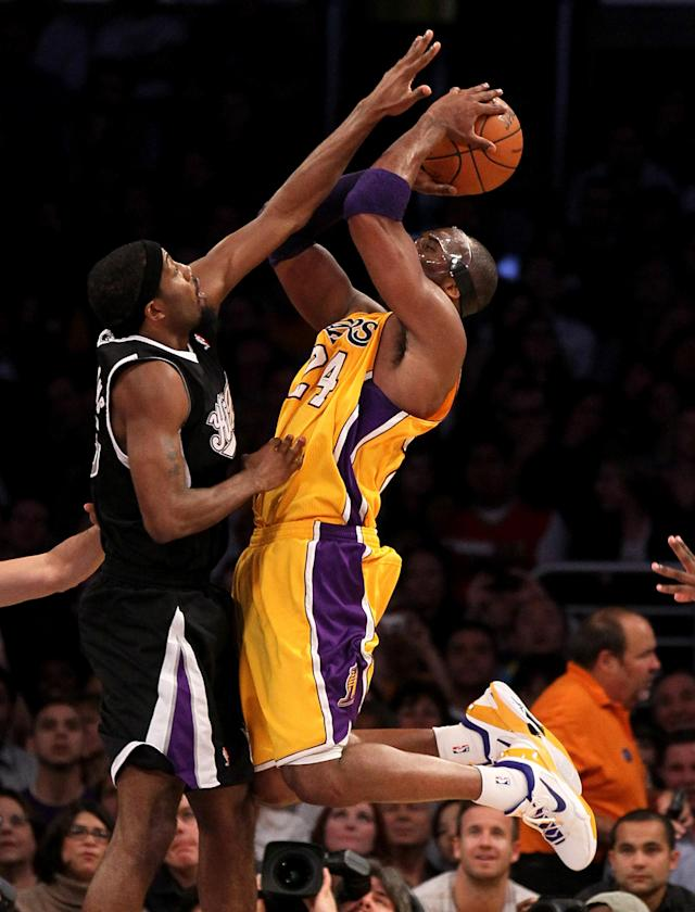 LOS ANGELES, CA - MARCH 02: Kobe Bryant #24 of the Los Angeles Lakers shoots against John Salmons #5 of the Sacramento Kings at Staples Center on March 2, 2012 in Los Angeles, California. The Lakers won 115-107. NOTE TO USER: User expressly acknowledges and agrees that, by downloading and or using this photograph, User is consenting to the terms and conditions of the Getty Images License Agreement. (Photo by Stephen Dunn/Getty Images)
