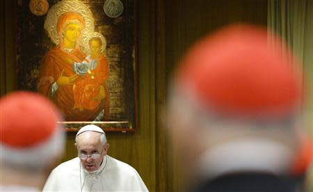 Pope Francis looks on as he arrives to lead a special consistory for the family in the Paul VI's hall at the Vatican February 20, 2014. REUTERS/Max Rossi
