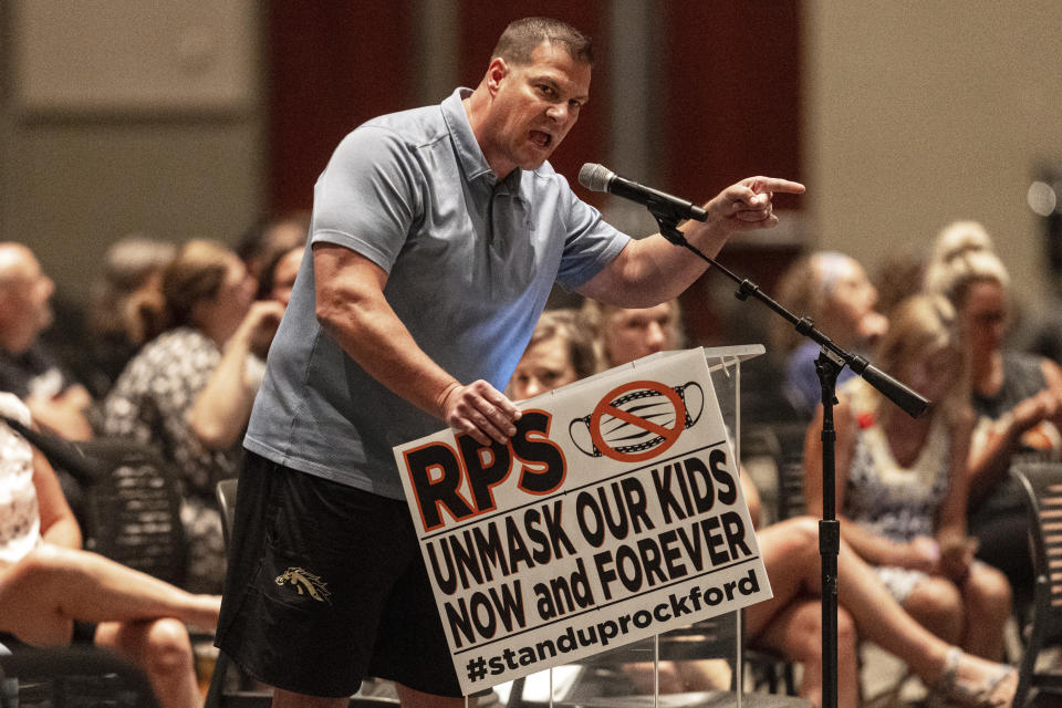 Craig Ladyman, of Rockford, speaks during the Kent County board meeting at DeVos Place in Grand Rapids, Mich., on Thursday, Aug. 26, 2021. The meeting was held after the Kent County Health Department issued a mask mandate for teachers and children preschool through sixth grade across the county. (Joel Bissell/Kalamazoo Gazette via AP)