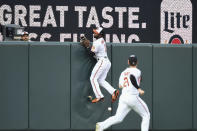 Baltimore Orioles center fielder Cedric Mullins attempts to catch a ball hit by Miami Marlins' Jesus Aguilar that fell for an RBI double during the first inning of a baseball game Wednesday, July 28, 2021, in Baltimore. (AP Photo/Terrance Williams)