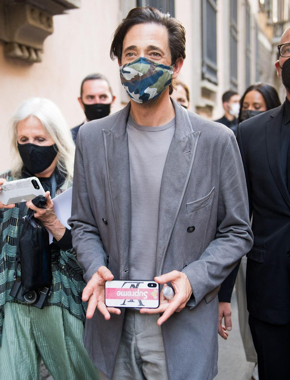 <p>Adrien Brody arrives at the Giorgio Armani Fashion Show during Milan Men's Fashion Week on June 21 in Milan.</p>