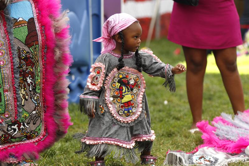 Jania Williams, 2, a Little Queen with the Cheyenne Mardi Gras Indian tribe, readies to parade with the tribe at the New Orleans Jazz and Heritage Festival in New Orleans, Thursday, May 3, 2012. (AP Photo/Gerald Herbert)