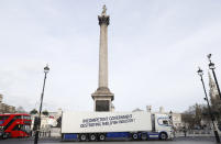"A shellfish export truck with a protest sign written across the trailer 'Incompetent Government Destroying Shellfish Industry"" drives around Trafalgar Square in London, Monday, Jan. 18, 2021, during a demonstration by British Shellfish exporters to protest Brexit-related red tape they claim is suffocating their business. (AP Photo/Alastair Grant)"