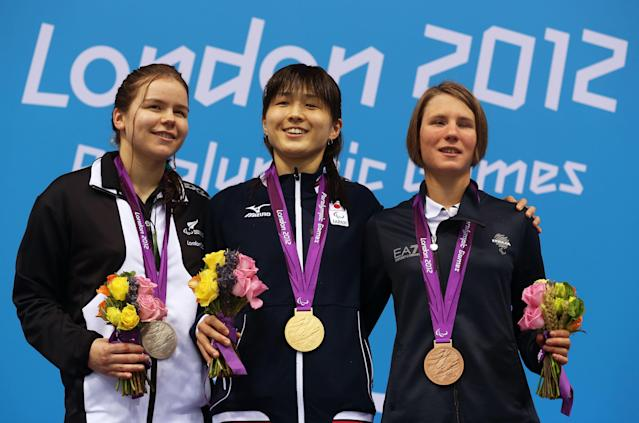 LONDON, ENGLAND - SEPTEMBER 02: (L-R) Silver medallist Mary Fisher of New Zealand, gold medallist Rina Akiyama of Japan and bronze medallist Cecilia Camellini of Italy pose on the podium during the medal ceremony for the Women's 100m Backstroke - S11 final on day 4 of the London 2012 Paralympic Games at Aquatics Centre on September 2, 2012 in London, England. (Photo by Clive Rose/Getty Images)