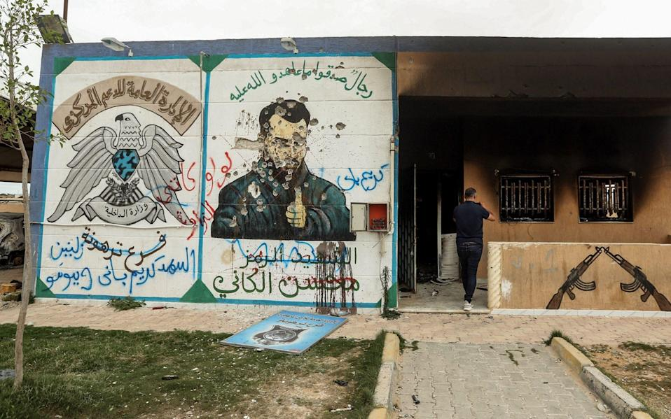 A mural of Libyan warlord Mohsen al-Kani outside a militia detention centre in Tarhuna, after the town was taken by pro-Tripoli forces last June - AFP
