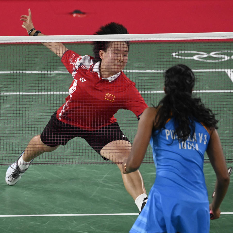 China's He Bingjiao (top) hits a shot to India's P. V. Sindhu in their women's singles badminton bronze medal match during the Tokyo 2020 Olympic Games at the Musashino Forest Sports Plaza in Tokyo on August 1, 2021. (Photo by Alexander NEMENOV / AFP) (Photo by ALEXANDER NEMENOV/AFP via Getty Images)