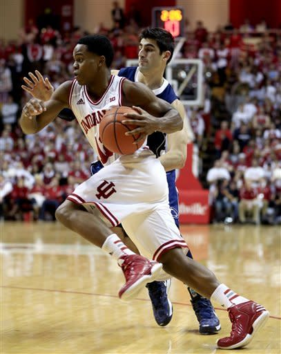 Indiana's Yogi Ferrell (11) drives to the basket against Penn State's Nick Colella during the second half of an NCAA college basketball game, Wednesday, Jan. 23, 2013, in Bloomington, Ind. Indiana won 72-49. (AP Photo/Darron Cummings)