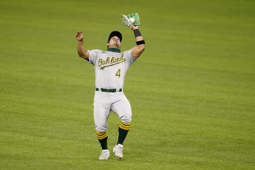 Oakland Athletics second baseman Franklin Barreto catches a pop out by Texas Rangers' Joey Gallo in the third inning of a baseball game in Arlington, Texas, Wednesday, Aug. 26, 2020. (AP Photo/Tony Gutierrez)