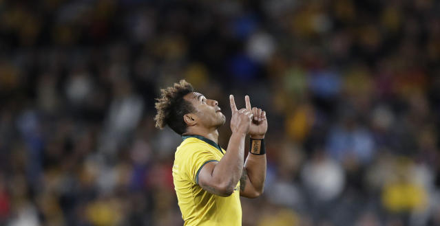 Australia's Will Genia points upwards as he leaves the field during their rugby union test match against Samoa in Sydney, Saturday, Sept. 7, 2019. (AP Photo/Rick Rycroft)
