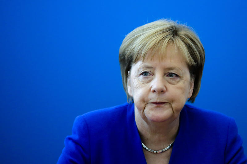 German Chancellor Angela Merkel leads a board meeting of her Christian Democratic Union party at the headquarters in Berlin, Monday, July 2, 2018. (AP Photo/Markus Schreiber)