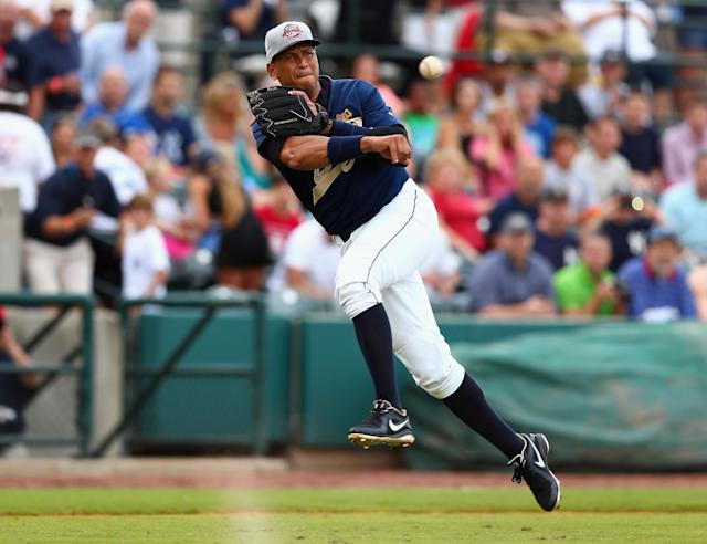 CHARLESTON, SC - JULY 02: Alex Rodriguez of the New York Yankess fields a ball during his game for the Charleston RiverDogs at Joseph P. Riley Jr. Park on July 2, 2013 in Charleston, South Carolina. (Photo by Streeter Lecka/Getty Images)