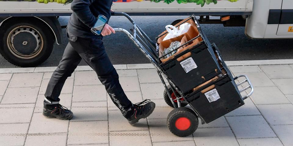 A worker delivers groceries to households in Stockholm, Sweden, on March 21, 2020.