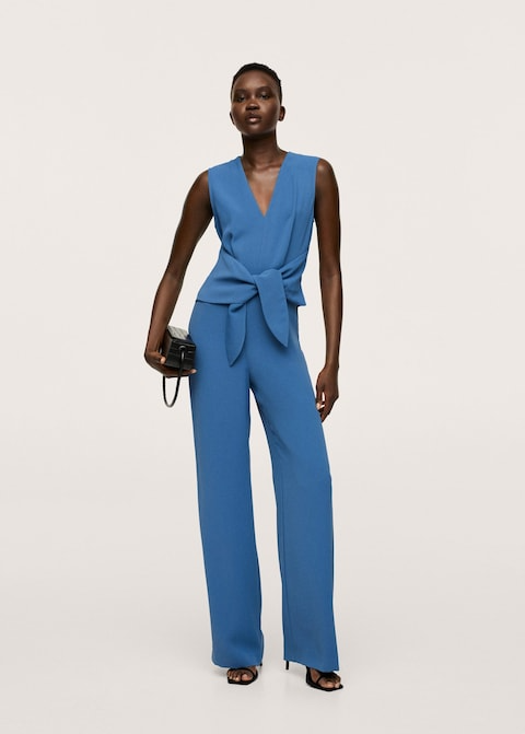 """<h2>Fall Wedding-Guest Jumpsuit Outfits</h2><br>For all the non-dress-wearers out there, here are a few night-out <a href=""""https://www.refinery29.com/en-us/jumpsuits"""" rel=""""nofollow noopener"""" target=""""_blank"""" data-ylk=""""slk:jumpsuits"""" class=""""link rapid-noclick-resp"""">jumpsuits</a> that are cocktail hour-ready — and will let you boogie on the dance floor all night long.<br><br><strong>Mango</strong> Bow wrap jumpsuit, $, available at <a href=""""https://go.skimresources.com/?id=30283X879131&url=https%3A%2F%2Fshop.mango.com%2Fus%2Fwomen%2Fdresses-and-jumpsuits-party%2Fbow-wrap-jumpsuit_17084760.html%3Fc%3D52"""" rel=""""nofollow noopener"""" target=""""_blank"""" data-ylk=""""slk:Mango"""" class=""""link rapid-noclick-resp"""">Mango</a>"""