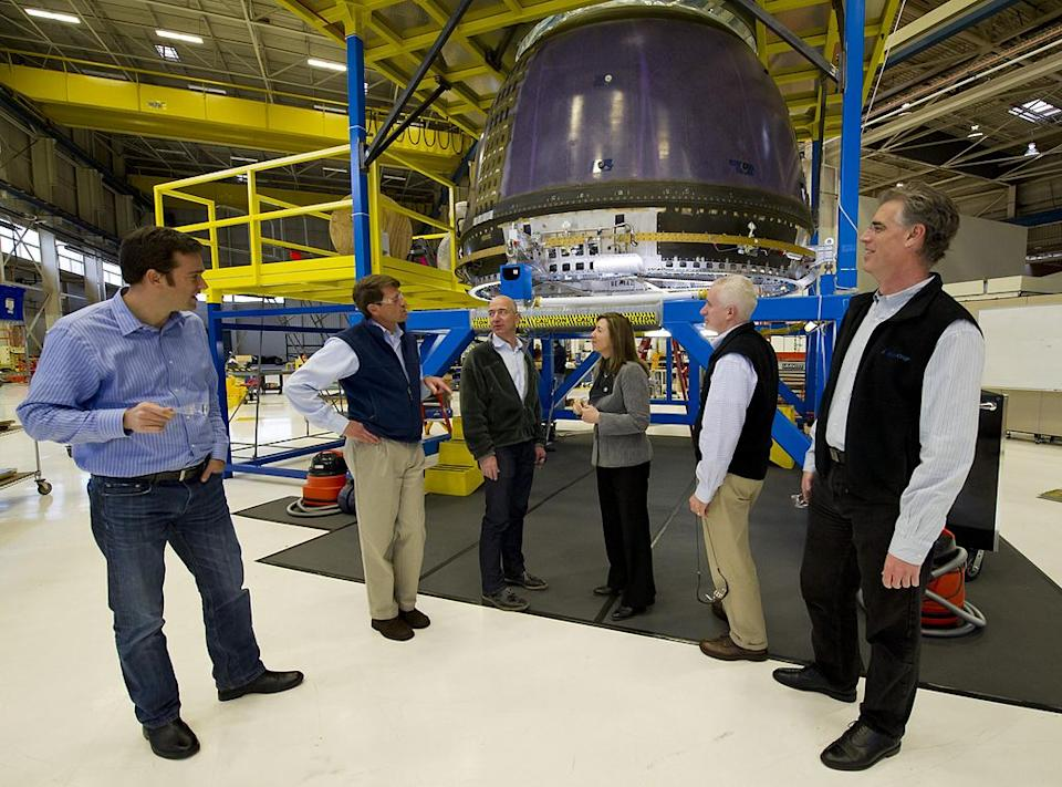 Bezos and Rob Meyerson (fifth from left) giving NASA Deputy Administrator Lori Garver (fourth from left) a tour of Blue Origin's crew capsule in 2011 / Photo: Wikimedia Commons